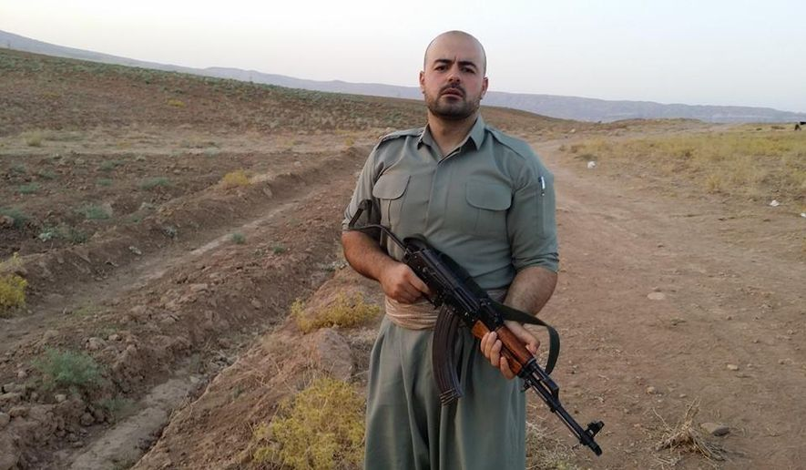 "In this image provided by Shaho Pirani shows  Shaho Pirani posing with an automantic weapon near the village of Koya in Iraqi Kurdistan in June 2014. The Iranian Kurd living in Denmark, was on a month-long training camp for the Kurdish diaspora organized by Iranian branch of the Kurdistan Democratic Party. He joined Kurds from Norway, Switzerland and Britain for a crash-course on politics followed by weapons training. Shaho Pirani says he's just a phone call away from leaving his quiet life in Denmark and joining Kurdish forces battling against Islamic State militants in Iraq. The 30-year-old Kurd, who fled from Iran with his older brother in 1991, says he feels a moral duty to help the Peshmerga, the armed forces of the Kurdistan Regional Government, to fight the ""psychopaths"" of the IS group. (AP Photo/Shaho Pirani)"
