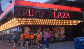 Several lights are burned out in the illuminated facade of Trump Plaza Hotel Casino in Atlantic City, N.J., on July 24, 2014. Trump Plaza is closing on Tuesday, Sept. 16, 2014, the fourth Atlantic City casino to go out of business so far this year. (AP Photo/Wayne Parry, File)