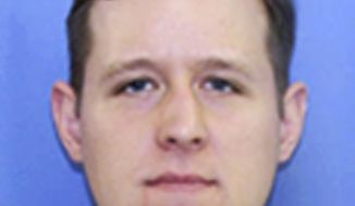This undated PennDOT identification photo released Tuesday, Sept. 16, 2014, by the Pennsylvania State Police shows Eric Matthew Frein, 31, of Canadensis, Penn., being sought in Friday's shooting that left one trooper dead and another critically wounded at a state police barracks in Blooming Grove. A gunman killed Cpl. Bryon Dickson, 38, and critically wounded Trooper Alex Douglass outside the barracks during a late-night shift change, then slipped away. (AP Photo/PennDOT via Pennsylvania State Police)