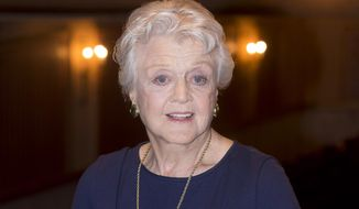 """In this Jan. 23, 2014 file photo, actress and singer Angela Lansbury is photographed on stage at the Gielgud Theatre in central London, as she returns to the West End this spring for the first time in nearly 40 years, with the play, """"Blithe Spirit,"""" by Noel Coward. (Photo by Joel Ryan/Invision/AP, File)"""