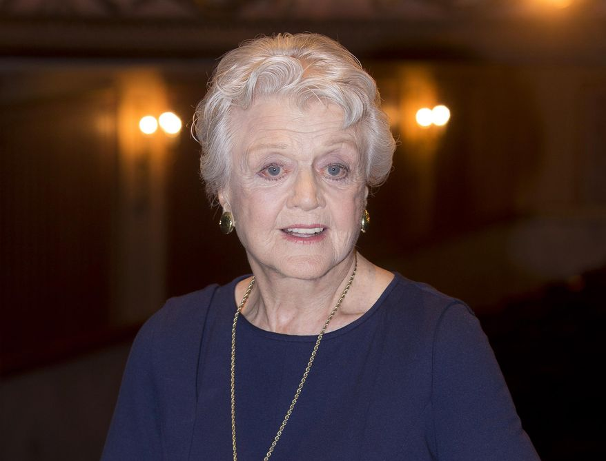 "In this Jan. 23, 2014 file photo, actress and singer Angela Lansbury is photographed on stage at the Gielgud Theatre in central London, as she returns to the West End this spring for the first time in nearly 40 years, with the play, ""Blithe Spirit,"" by Noel Coward. (Photo by Joel Ryan/Invision/AP, File)"