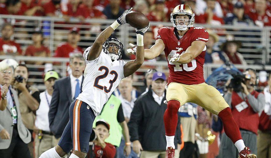 Chicago Bears cornerback Kyle Fuller (23) intercepts a pass intended for San Francisco 49ers tight end Derek Carrier during the fourth quarter of an NFL football game in Santa Clara, Calif., Sunday, Sept. 14, 2014. (AP Photo/Tony Avelar)