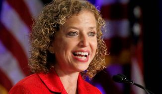 FILE - This Aug. 23, 2013 file photo shows Democratic National Committee chair, Rep. Debbie Wasserman Schultz, D-Fla. speaking in Scottsdale, Ariz. Democrats plan to travel to six cities this summer to evaluate potential sites for the 2016 Democratic National Convention. Officials with the Democratic National Committee are studying how each city might accommodate the tens of thousands of party leaders and activists who will flock to the convention, where the party will nominate its next presidential candidate. Wasserman Schultz is expected to announce the host city later this year or in early 2015.  (AP Photo/Ross D. Franklin, File)