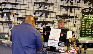 Ordnance: Gun retailers, like SSG Tactical in Fredericksburg, Virginia, must have firearms purchasers fill out a form indicating their race or else face ATF sanctions. (Kelly Riddell/The Washington Times)