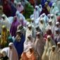 Muslim women perform an evening prayer called 'tarawih' marking the first eve of the holy fasting month of Ramadan n Jakarta, Indonesia in June. Fears about the threat posed by the Islamic State are mounting not only in the West but also in the capital of the world's most populous Muslim nation. (AP Photo/Tatan Syuflana)