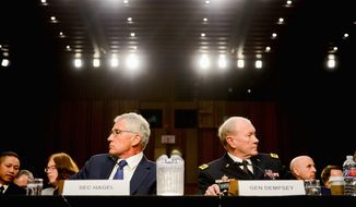 architects: Secretary of Defense Chuck Hagel and the Chairman of the Joint Chiefs of Staff Gen. Martin E. Dempsey remain in the process of continuing to shape Obama administration activities to rout the Islamic State terrorist group. (Andrew Harnik/The Washington Times)