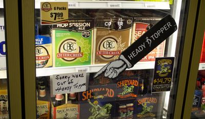 Beer is displayed at Beverage Baron in Barre, Vt., in this Sept. 11, 2014, file photo. (AP Photo/J.M. Hirsch)