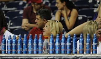 Football fans line up 17 beer bottles during the second half of an NFL preseason football game between the Houston Texans and the Minnesota Vikings Thursday, Aug. 30, 2012, in Houston. The Texans won 28-24.(AP Photo/Pat Sullivan)