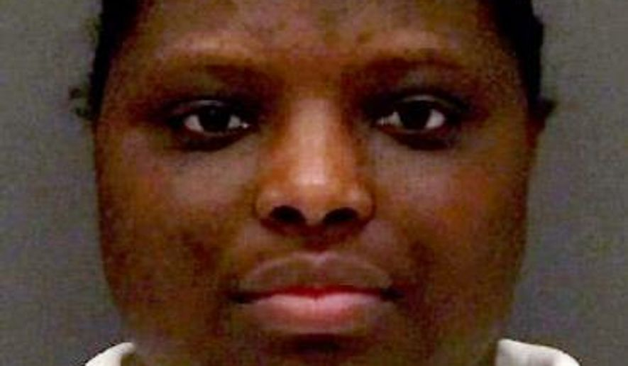This undated handout photo provided by the Texas Department of Criminal Justice shows Lisa Ann Coleman. On Wednesday, Sept. 17, 2014, Coleman is set for execution for the 9-year-old  Davontae Williams' starvation death 10 years ago. (AP Photo/Texas Department of Criminal Justice)
