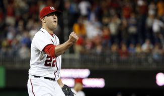 Washington Nationals relief pitcher Drew Storen celebrates after a baseball game against the Atlanta Braves at Nationals Park, Monday, Sept. 8, 2014, in Washington. The Nationals won 2-1. (AP Photo/Alex Brandon)