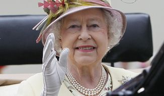 In this Friday June 17, 2011, file photo, Britain's Queen Elizabeth II waves as she arrives by carriage on the fourth day of the Royal Ascot horse race meeting at Ascot, England. (AP Photo/Alastair Grant, File)