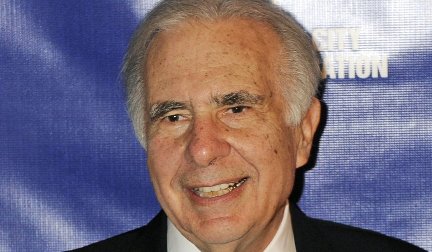 FILE - In this March 16, 2010 file photo, financier Carl Icahn poses for photos upon arriving for the 32nd annual New York City Police Foundation Gala in New York. Dodging a proxy fight with Icahn, Hertz on Tuesday, Sept. 16, 2014 announced it is adding three of his chosen candidates to the board. (AP Photo/Henny Ray Abrams, File)
