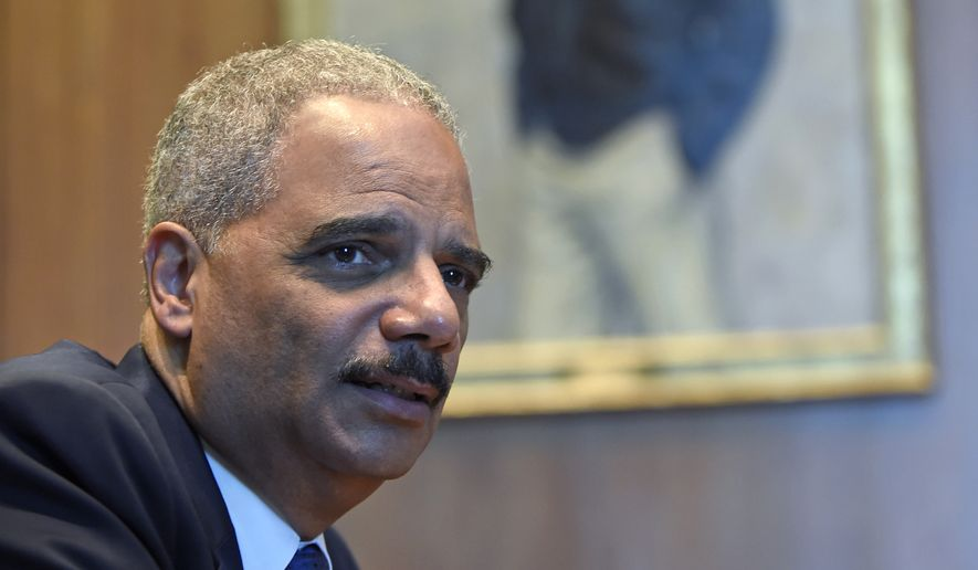 Attorney General Eric Holder speaks during an interview with The Associated Press at the Justice Department in Washington, Tuesday, Sept. 16, 2014.  Broadening its push to improve police relations with minorities, the Justice Department has enlisted a team of criminal justice researchers to study racial bias in law enforcement in five American cities and recommend strategies to address the problem nationally, Holder said Tuesday. (AP Photo/Susan Walsh)