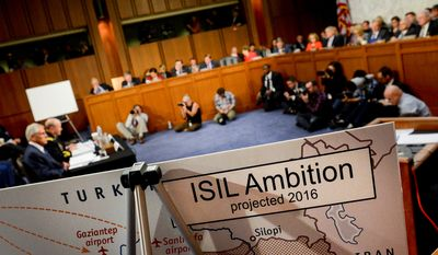 Posters depicting ISIL ambition in Syria and Iraq are displayed as Secretary of Defense Chuck Hagel and the Chairman of the Joint Chiefs of Staff Martin Dempsey testify concerning the Islamic State of Iraq and the Levant (ISIL) in front of the Senate Armed Services Committee on Capitol Hill, Washington, D.C., Tuesday, September 16, 2014. (Andrew Harnik/The Washington Times)