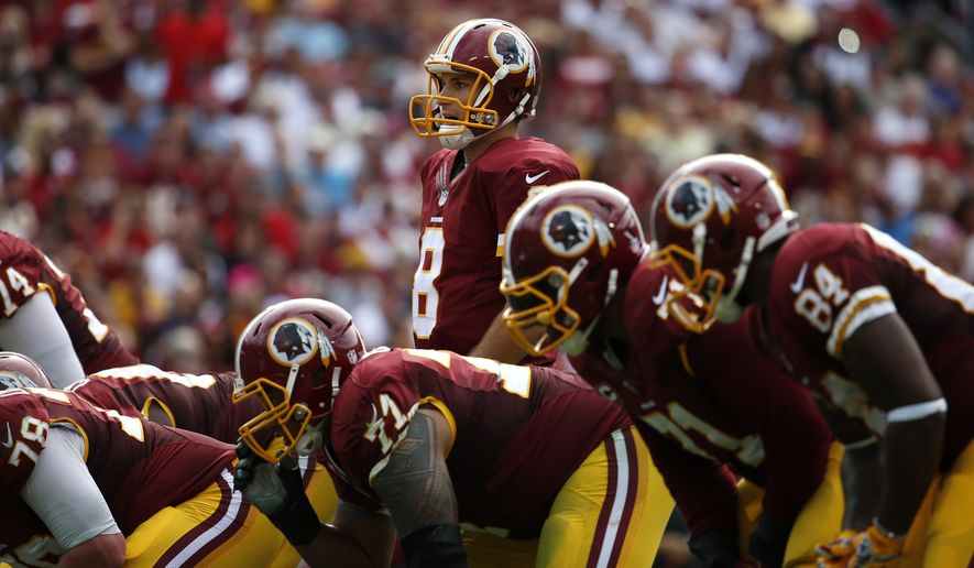 Washington Redskins quarterback Kirk Cousins (8) lines up during the second half of an NFL football game against the Jacksonville Jaguars on Sunday, Sept. 14, 2014, in Landover, Md. (AP Photo/Evan Vucci)