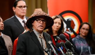National Congress of American Indians President Brian Cladoosby, second from left, wears a traditional cedar hat as he speaks along with other Native American leaders, Members of Congress, religious and civil rights leaders speak at a Change the Mascot campaign press conference on Capitol Hill to speak out on changing the name of the Washington Redskins, Washington, D.C., Tuesday, September 16, 2014. (Andrew Harnik/The Washington Times)