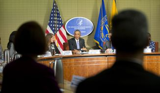 President Barack Obama, center, and Secretary of Health and Human Services, Sylvia Mathews Burwell, left, meet with Emory University Doctors and healthcare professionals at the Centers for Disease Control and Prevention (CDC) in Atlanta, Tuesday, Sept. 16, 2014. Obama traveled to the CDC to address the Ebola crisis and announced that he is sending 3,000 American troops to West Africa nations fight the spread of the Ebola epidemic. (AP Photo/Pablo Martinez Monsivais)