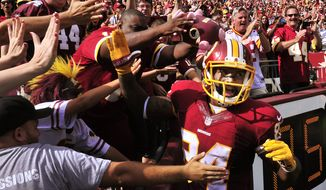 Washington Redskins tight end Niles Paul (84)  celebrates with the fans after his second touchdown reception of the day against the Jacksonville Jaguars at FedEx Field, Sept. 14, 2014. (Preston Keres/Special for The Washington Times)