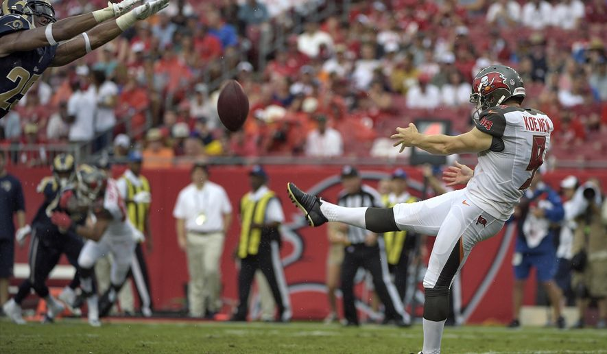 FILE - In this Sept. 14, 2014, file phot, St. Louis Rams strong safety T.J. McDonald, left, comes in to block a punt by Tampa Bay Buccaneers punter Michael Koenen (9) during the second quarter of an NFL football game in Tampa, Fla. McDonald had two blocked kicks in the game.  (AP Photo/Phelan M. Ebenhack, File)