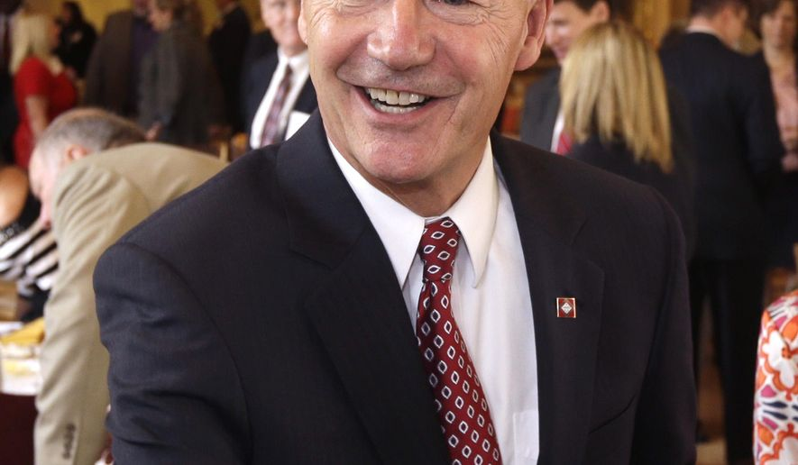 Republican candidate for Arkansas governor Asa Hutchinson arrives at a meeting of the Political Animals Club in Little Rock, Ark., Wednesday, Sept. 17, 2014. Hutchinson faces Democrat Mike Ross in the November election. (AP Photo/Danny Johnston)