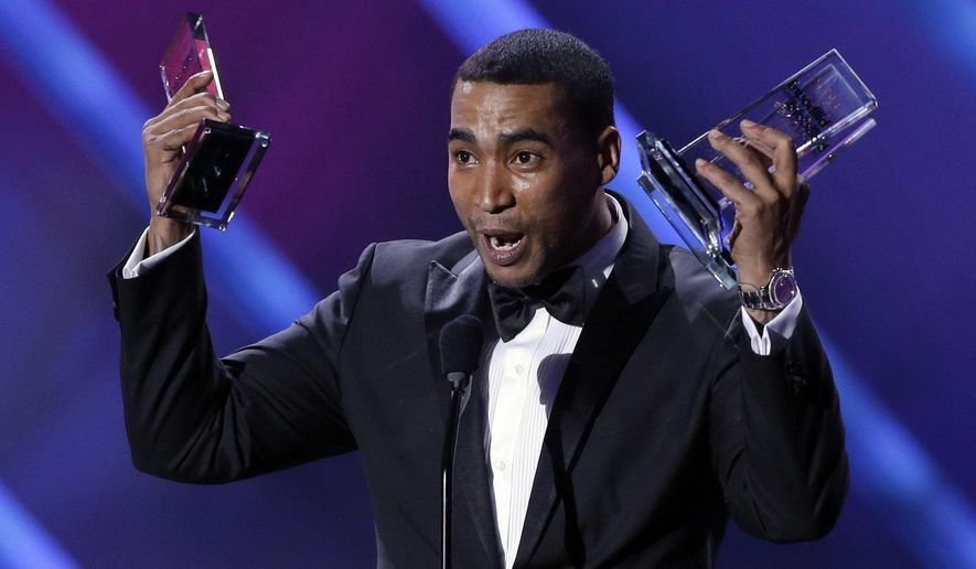 FILE - In this April 25, 2013 file photo, Puerto Rico reggaeton star Don Omar receives his tenth award at the Latin Billboard Awards in Coral Gables, Fla. Authorities said in a statement that 36-year-old William Omar Landron Rivera was detained early Wednesday, Sept. 17, 2014, at a house in the northern coastal Puerto Rican town of Vega Alta. Authorities said he is suspected of threatening his 26-year-old partner. (AP Photo/Alan Diaz, File)