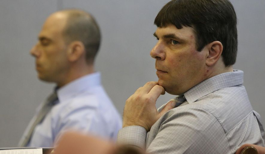Murder suspects and brothers Paul Jones, left, and Matthew Jones wait during a recess for court to resume on the first day of their preliminary exam on Wednesday, Sept. 17, 2014 in Newaygo County's 78th District Court before Judge Brad Lambrix. The Joneses are co-defendants charged in the the death of Shannon Siders in 1989. Siders was last seen alive on July 18, 1989. Her body was found on October 15, 1989 by a hunter in Newaygo County's Brooks Township. (AP Photo/The Muskegon Chronicle, Ken Stevens)