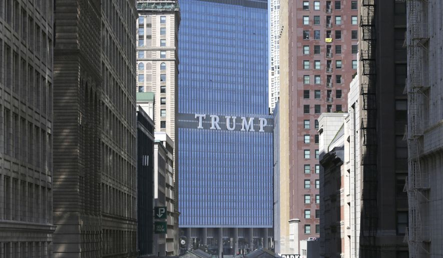 The Trump International Hotel and Tower is seen looking north on Wabash Ave. in Chicago's famed Loop Wednesday, Sept. 17, 2014. Chicago will always have the TRUMP sign on one of its tallest buildings to remind everyone in big, bold letters how Mayor Rahm Emanuel got trumped by The Donald, but now the mayor is proposing an ordinance to make sure nobody else can do the same. (AP Photo/Charles Rex Arbogast)