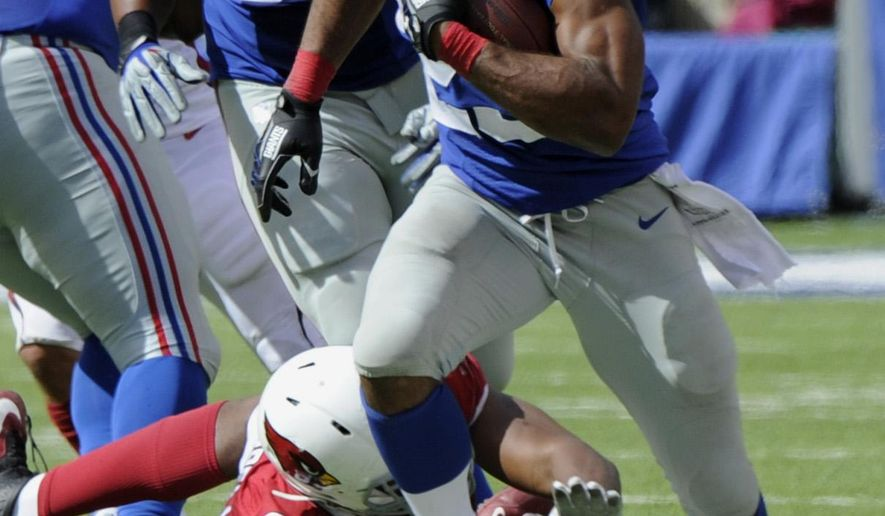 New York Giants running back Rashad Jennings (23) runs away from Arizona Cardinals' Calais Campbell (93) during the second half of an NFL football game Sunday, Sept. 14, 2014, in East Rutherford, N.J.  (AP Photo/Bill Kostroun)