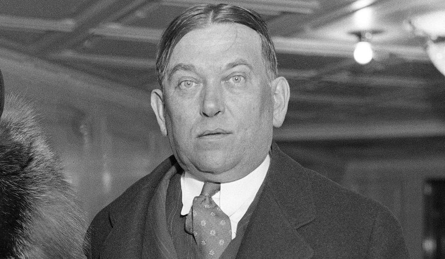 "FILE - In this Jan. 27, 1932 file photo, writer, H.L. Mencken is photographed on board the S.S. Columbus in New York. Next week, the Library of America will publish ""The Days Trilogy,"" a bound and expanded edition of three popular memoirs by the celebrated journalist and linguist that were released in the 1940s: ""Happy Days,"" ""Newspaper Days"" and ""Heathen Days."" (AP Photo/File)"
