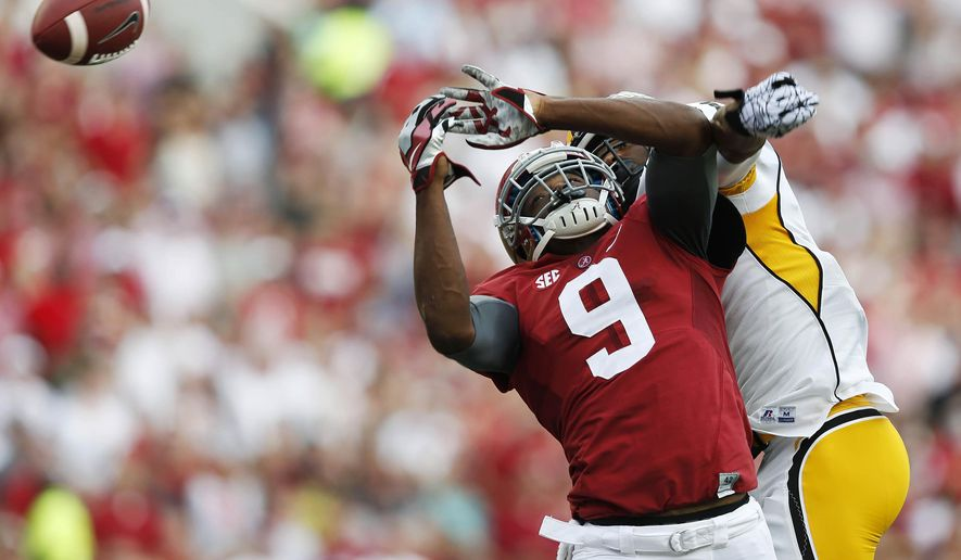 10ThingstoSeeSports - Alabama wide receiver Amari Cooper (9) misses a catch against Southern Mississippi defensive back Kalan Reed during the first half of an NCAA college football game Saturday, Sept. 13, 2014, in Tuscaloosa, Ala. (AP Photo/Brynn Anderson, File)