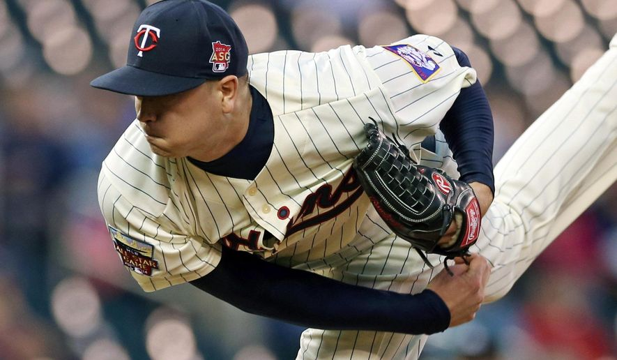 Minnesota Twins pitcher Kyle Gibson throws against the Detroit Tigers in the first inning of a baseball game, Wednesday, Sept. 17, 2014, in Minneapolis. (AP Photo/Jim Mone)