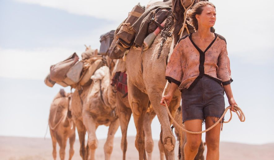 """In this image released by The Weinstein Company,  Mia Wasikowska appears in a scene from """"Tracks."""" (AP Photo/The Weinstein Company, Matt Nettheim)"""