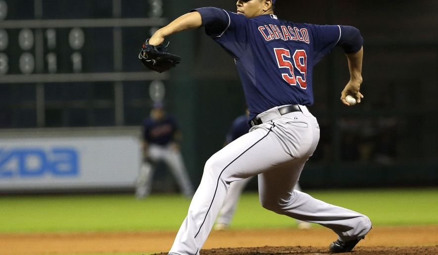 Cleveland Indians starting pitcher Carlos Carrasco throws against the Houston Astros during the eighth inning of a baseball game Wednesday, Sept. 17, 2014, in Houston. (AP Photo/David J. Phillip)