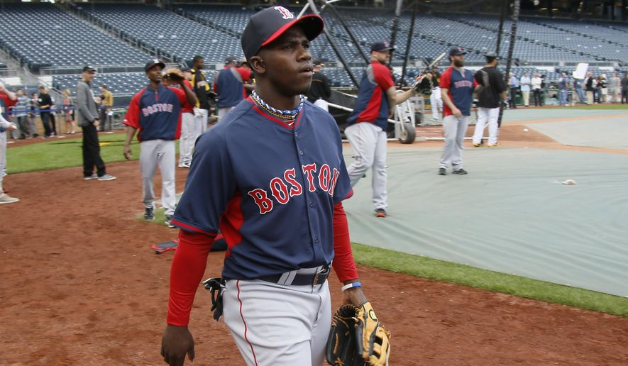 Boston Red Sox center fielder Rusney Castillo, center, heads to the outfield during batting practice before the baseball game against the Pittsburgh Pirates on Wednesday, Sept. 17, 2014, in Pittsburgh. Castillo is expected to make his Major League debut in the game. (AP Photo/Keith Srakocic)