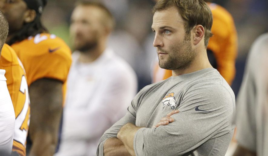 In this Aug. 28, 2014, file photo, Denver Broncos wide receiver Wes Welker (83) watches the action from the sideline in the second half of a NFL preseason football game against the Dallas Cowboys in Arlington, Texas. The NFL reached an agreement with the players association on changes to its performance-enhancing drug policy, including the addition of human growth hormone testing, which will allow the Welker and two other previously suspended players to return to their teams this week. Under the new rules announced Wednesday, Sept. 17, 2014, players who test positive for banned stimulants in the offseason will no longer be suspended. Instead, they will be referred to the substance abuse program. (AP Photo/LM Otero, File)
