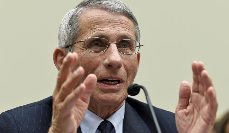 Dr. Anthony Fauci, the director of the National Institute of Allergy and Infectious Diseases, testifies before the House Foreign Affairs subcommittee on Africa, Global Health, Global Human Rights, and International Organizations hearing on the Ebola virus on Capitol Hill in Washington, Wednesday, Sept. 17, 2014. (AP Photo/Susan Walsh)