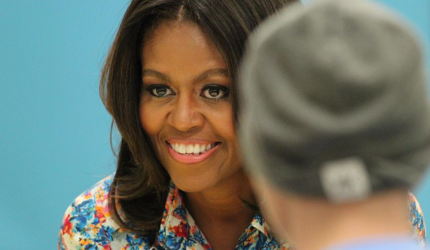 The First Lady of the United States, Michelle Obama, visits St. Jude Children's  Research Hospital in Memphis, Tenn. Wednesday, Sept. 17, 2014.  St. Jude is considered a leading researcher of cancer and other life-threatening diseases that affect children. (AP Photo/The Commercial Appeal, Nikki Boertman)