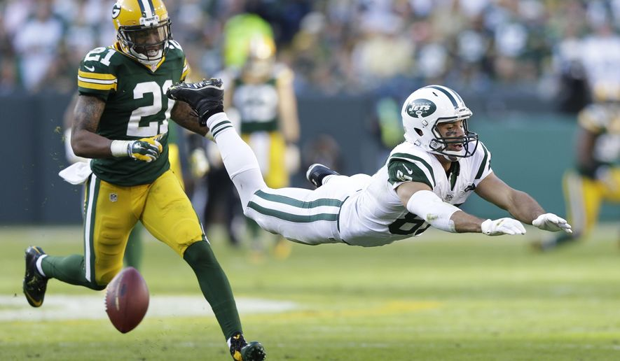 New York Jets' Eric Decker can't catch a pass in front of Green Bay Packers' Ha Ha Clinton-Dix (21) during the second half of an NFL football game Sunday, Sept. 14, 2014, in Green Bay, Wis. (AP Photo/Tom Lynn)