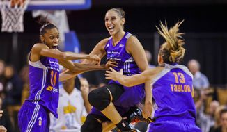 10ThingstoSeeSports - Phoenix Mercury's DeWanna Bonner (24) celebrating with Diana Taurasi and Penny Taylor (13) as the team wins the WNBA championship with an 87-82 win over the Chicago Sky in Game 3 of the WNBA Finals basketball series, Friday, Sept. 12, 2014, in Chicago. (AP Photo/Kamil Krzaczynski, File) **FILE**
