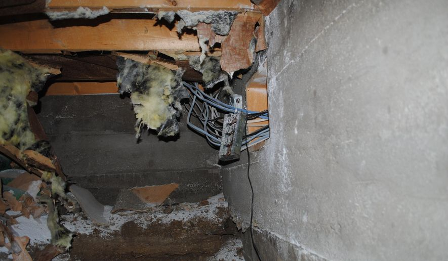A September, 2014,  photo released by the Chaffee County Sheriff's Office is of an electric circuit box in the crawlspave under the home of Edwin Bartheld in the ghost town of Turret, Colo.  Bartheld's body was found surrounded by explosive in the crawl space under his house.     (AP Photo/Chaffee County Sherriff)