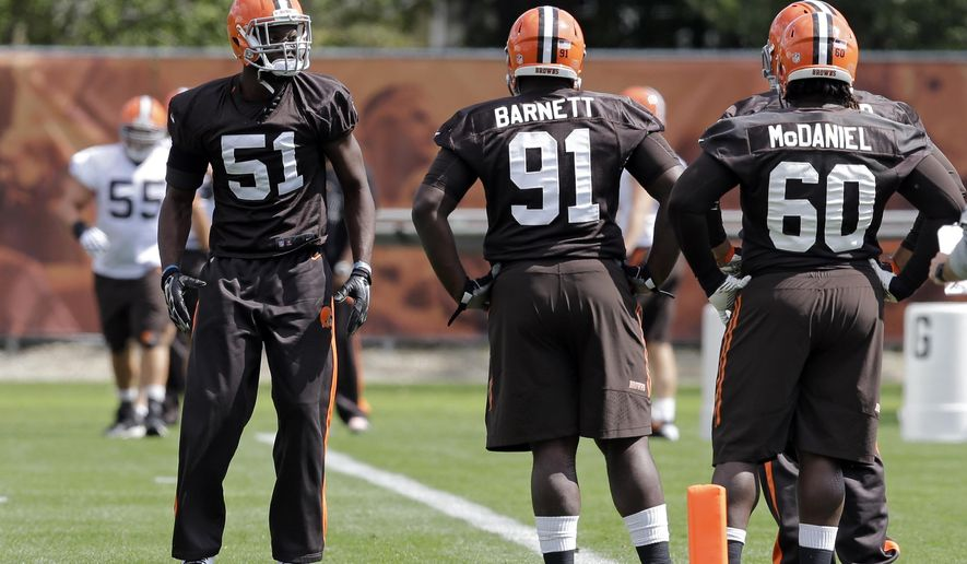 Cleveland Browns linebacker Barkevious Mingo (51) warms up before practice at the NFL football team's facility in Berea, Ohio, Wednesday, Sept. 17, 2014. Mingo was back in practice after sitting out last Sunday's game against the New Orleans Saints with injuries to both shoulders. (AP Photo/Mark Duncan)