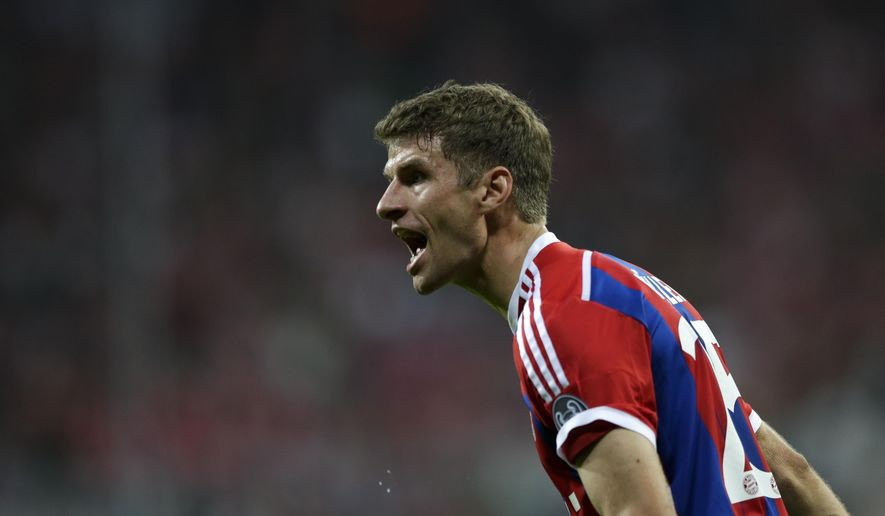 Bayern's Thomas Mueller reacts during the Champions League Group E soccer match between FC Bayern Munich and Manchester City at Allianz Arena in Munich, southern Germany, Wednesday Sept. 17, 2014. (AP Photo/Matthias Schrader)