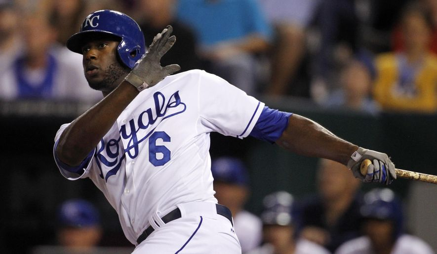 Kansas City Royals' Lorenzo Cain singles in the fourth inning of a baseball game against the Chicago White Sox at Kauffman Stadium in Kansas City, Mo., Wednesday, Sept. 17, 2014. (AP Photo/Colin E. Braley)