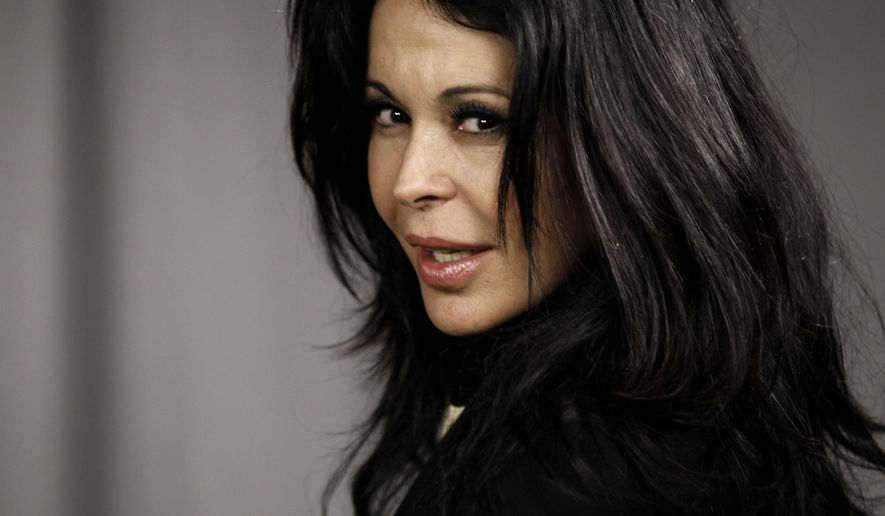FILE - In this July 7, 2010 file photo, Cuban-born actress Maria Conchita Alonso poses for a portrait in Los Angeles, California. Venezuela's authorities announced on Wednesday, Sept. 17, 2014, that they began proceedings to revoke Alonso's Venezuelan citizenship.  Alonso, who was born in Cuba and moved to Venezuela at age 5, was a strong critic of the government of Venezuela's late President Hugo Chavez. (AP Photo/Matt Sayles, File)