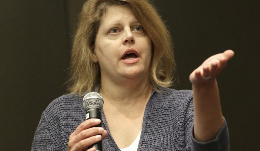 Sally Buzbee, Chief of Bureau for The Associated Press in Washington, D.C., responds to a question during a session of the APME conference dealing with media access from the local level to the White House, Wednesday, Sept. 17, 2014, in Chicago. (AP Photo/Charles Rex Arbogast)