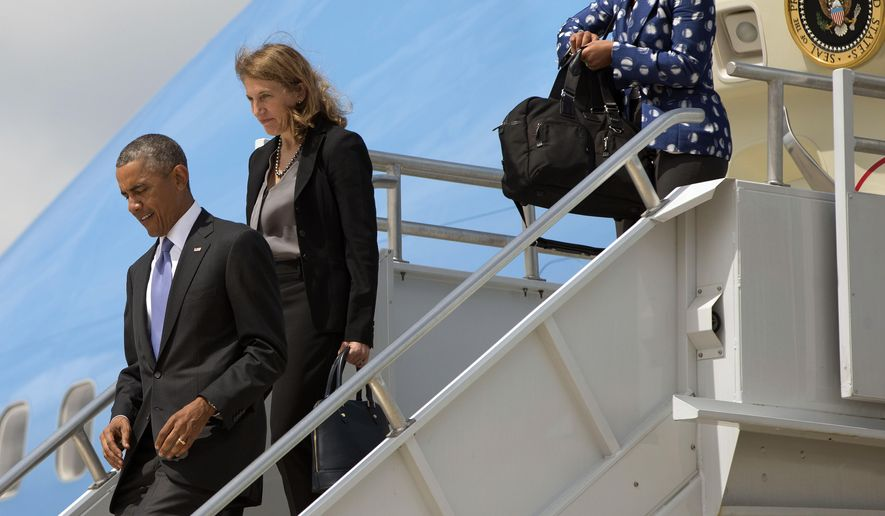 President Barack Obama, left, walks down the stairs of Air Force One accompanied by Sec. of Health and Human Services, Sylvia Mathews Burwell, center, and National Security Advisor Susan Rice, right, during their arrival at Hartsfield-Jackson Atlanta International Airport, Tuesday, Sept. 16, 2014, in Atlanta. Obama is traveling to Centers for Disease and Control and Prevention (CDC), to address the Ebola crisis and announce a plan to help the West Africa nations fight the spread of the Ebola virus. (AP Photo/Pablo Martinez Monsivais)