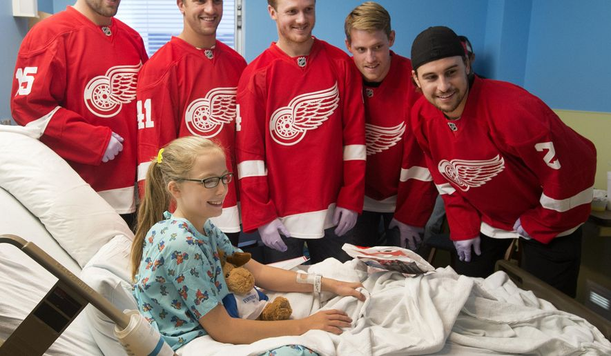 Detroit Red Wings NHL hockey players from left, Riley Sheahan, Luke Glendening, Gustav Nyquist, Joakim Andersson and Brendan Smith pose for a photo with Taylor Little, 11, of Saginaw, Mich., on the pediatric floor of Covenant HealthCare in Saginaw, Mich., Wednesday, Sept. 17, 2014. The five members of the Red Wings are touring Michigan on a preseason caravan. (AP Photo/The Saginaw News, Jeff Schrier) ALL LOCAL TELEVISION OUT; LOCAL TELEVISION INTERNET OUT