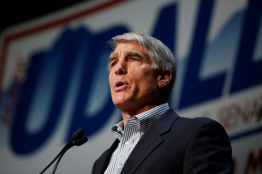 A recent campaign ad by Democratic Sen. Mark Udall claiming Republican opponent, Cory Gardner, voted to shut down the government as Colorado was cleaning up from a devastating flood has sparked outrage. (Associated Press Photographs)