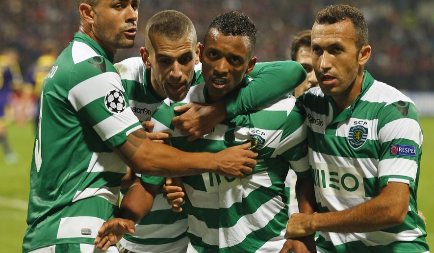 Sporting's Nani, center, celebrates his goal with his teammates during the Champions League Group G soccer match between Maribor and Sporting, in Maribor, Slovenia, Wednesday, Sept. 17, 2014. (AP Photo/Darko Bandic)