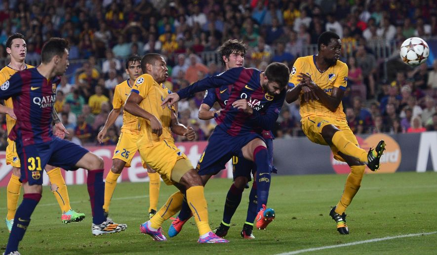 Barcelona's Gerard Pique, 2nd from right, scores with a header against APOEL during the Champions League Group F soccer match between Barcelona and Apoel at the Camp Nou stadium in Barcelona, Spain, Wednesday, Sept. 17, 2014. (AP Photo/Manu Fernandez)